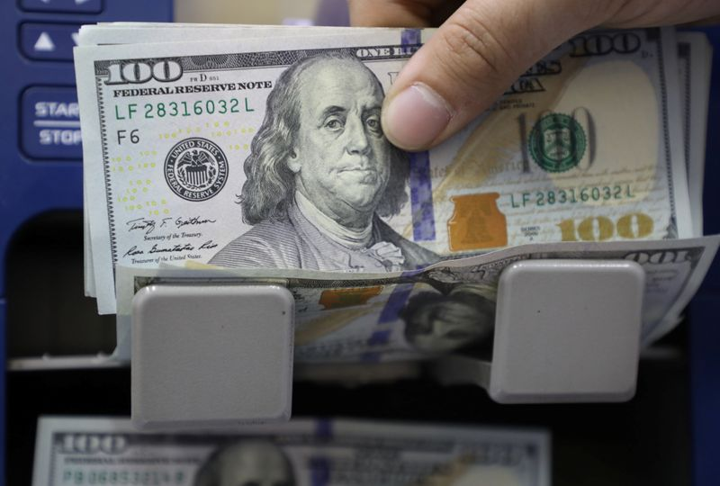 Dollar on back foot as U.S. yields drop despite strengthening U.S. recovery