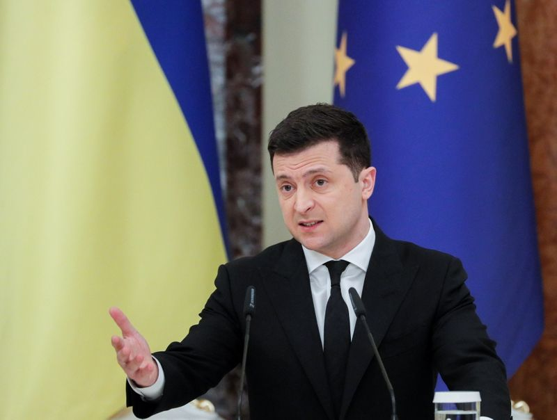 Ukraine calls for path into NATO after Russia masses troops
