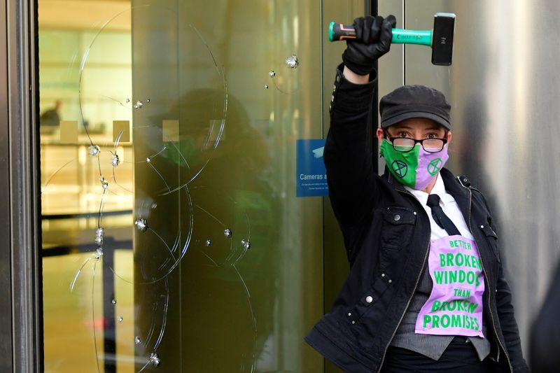 Climate protesters break windows at Barclays London HQ, seven arrested