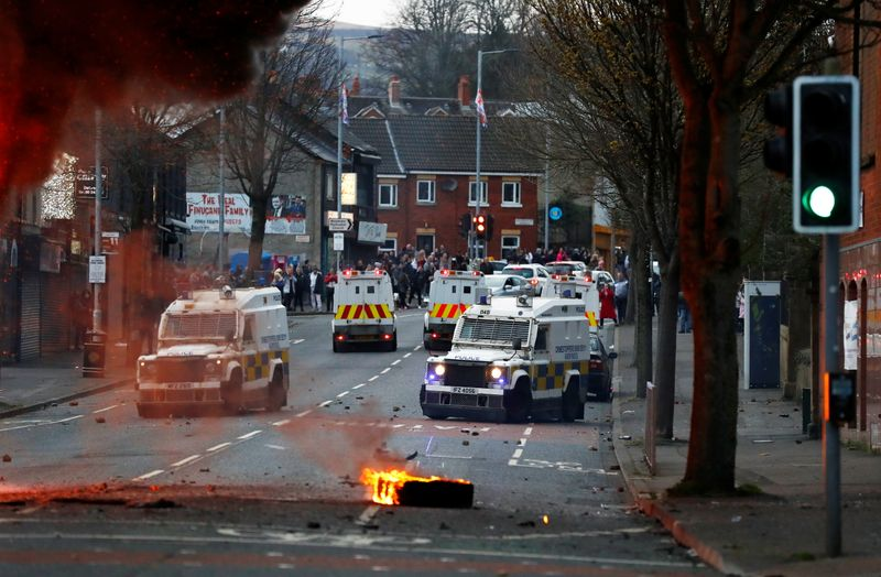 UK PM urges calm as Belfast protesters hijack bus, attack police