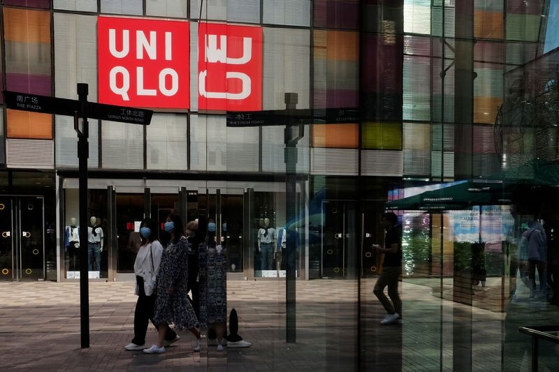 Uniqlo owner reports 23% rise in half-year profit