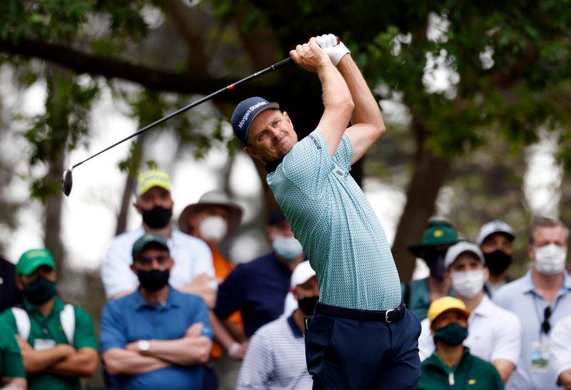 Golf-Rose leads Masters, defending champion Johnson misses cut