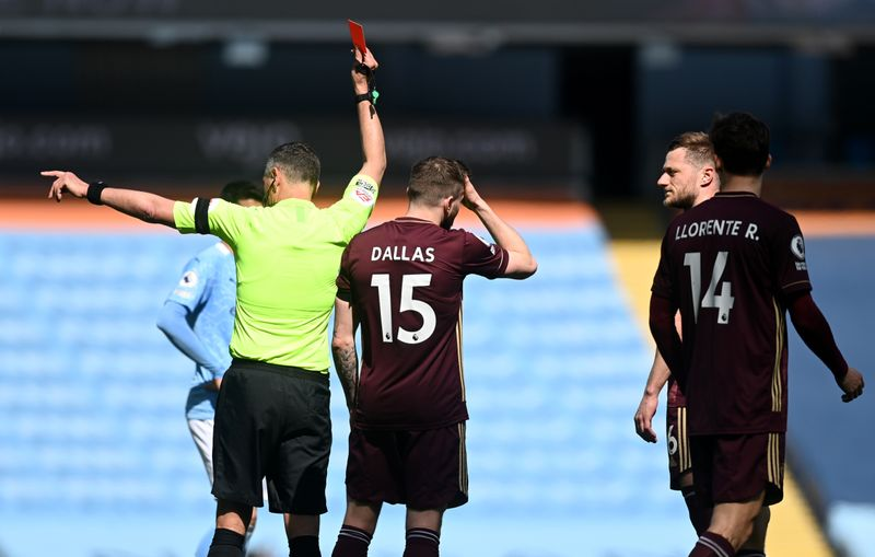 Soccer: Ten-man Leeds snatch last-gasp win at Man City