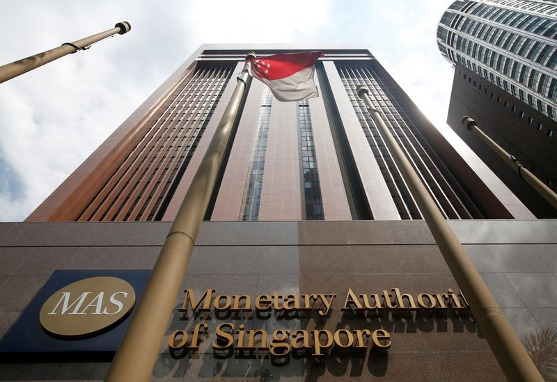 Singapore keeps monetary policy on hold amid patchy recovery