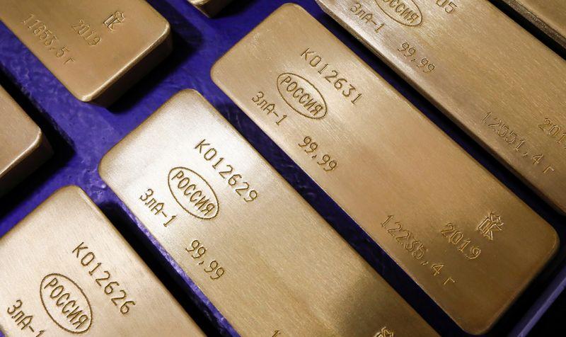 METALES PRECIOSOS-Oro se encamina a su mejor semana en cinco por baja de rendimientos bonos EEUU