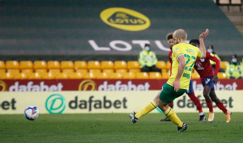 Soccer-Norwich promoted to Premier League despite defeat as rivals drop points