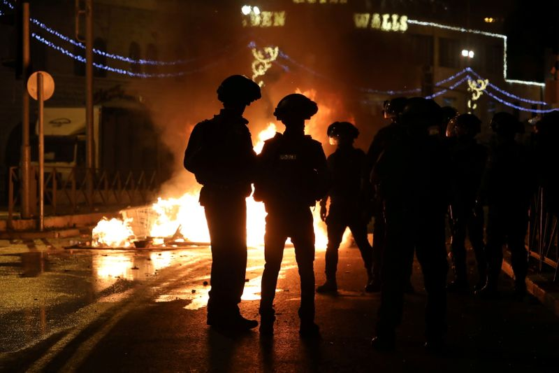 Police arrest dozens in Jerusalem clashes; Israeli nationalists chant 'Death to Arabs