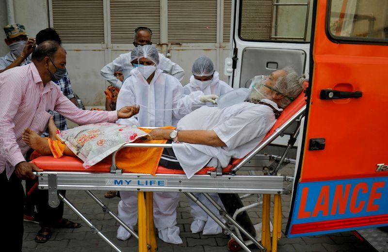 Rush to hospitals, big gatherings worsen India COVID crisis - WHO