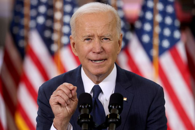After somber tone in first 100 days, Biden plans to try to sell spending to U.S. public