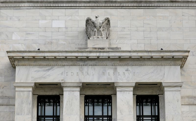 Fed nods to strengthening economy but waves off talk of policy shift