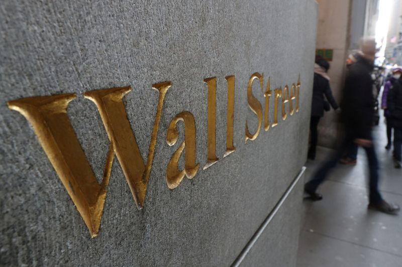 Wall Street ends lower, weighed down by Apple