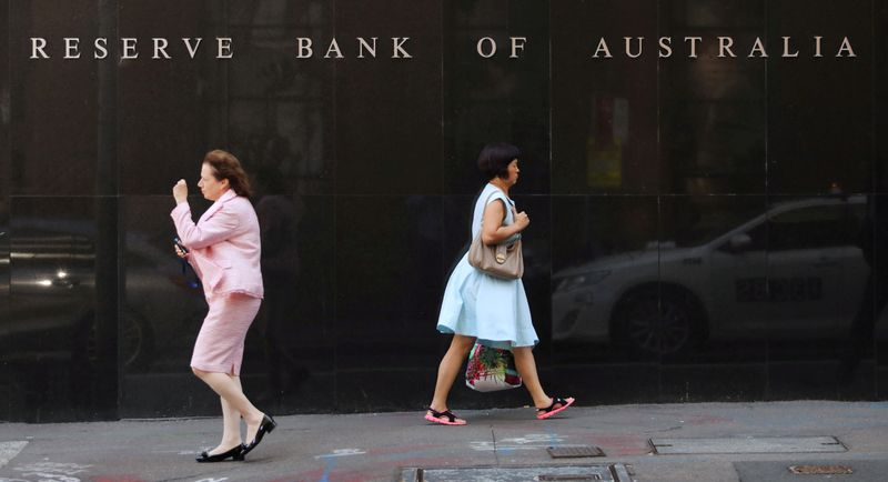 Australia central bank keeps rates near zero as economy picks up speed