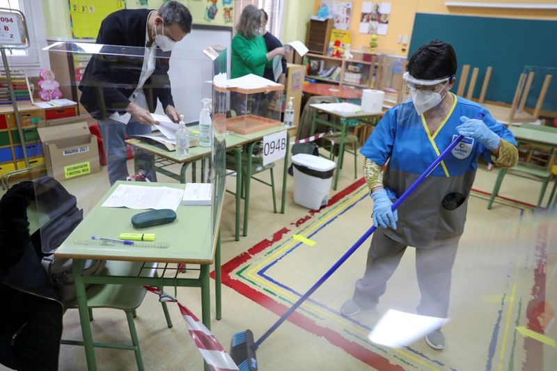 Madrid voters queue at polls in COVID-influenced crunch election