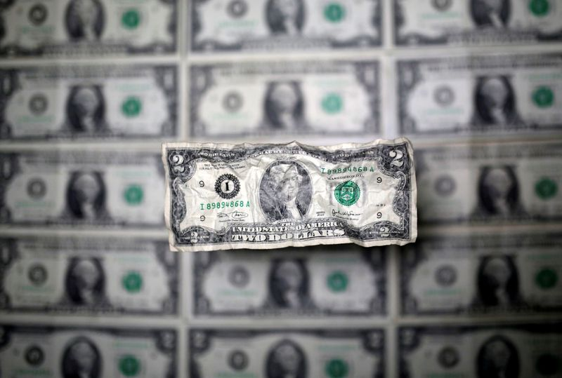 Dollar slips from two-week high; Bank of England meeting in focus