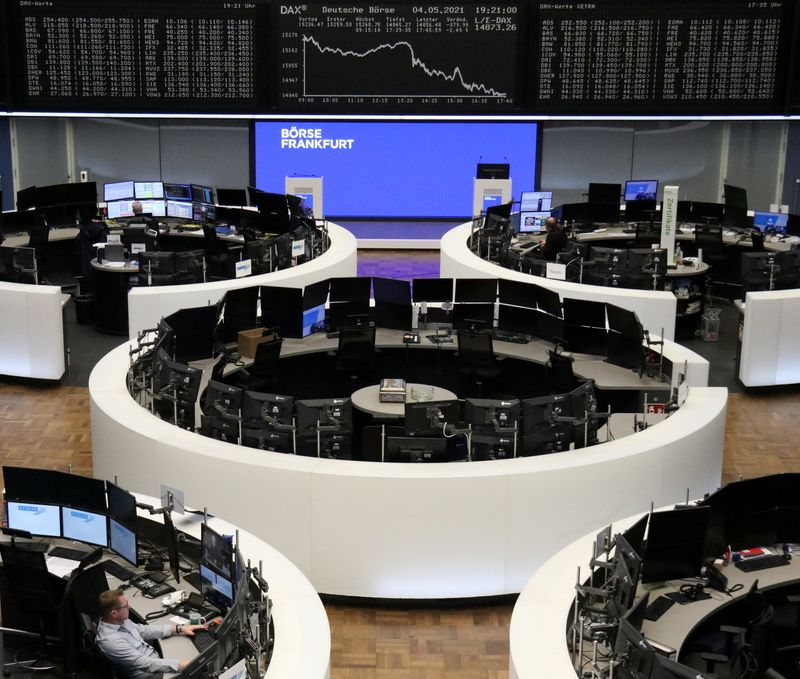 European shares end lower as oil, tech losses offset earnings boost