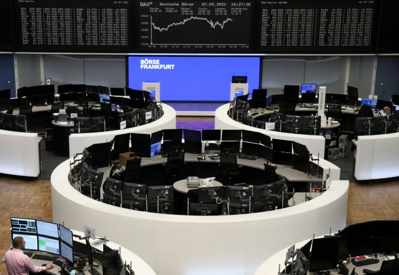 European stocks end at record highs as miners rally