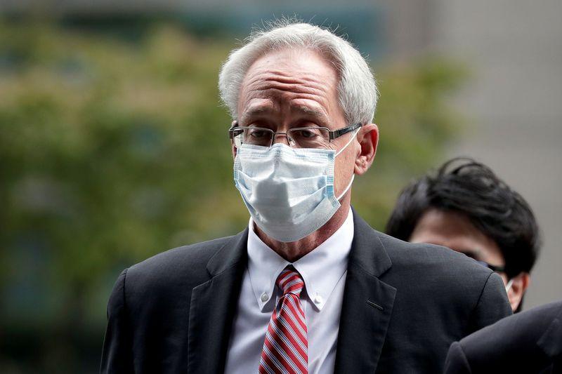 In court, former Nissan executive Kelly denies helping Ghosn hide earnings