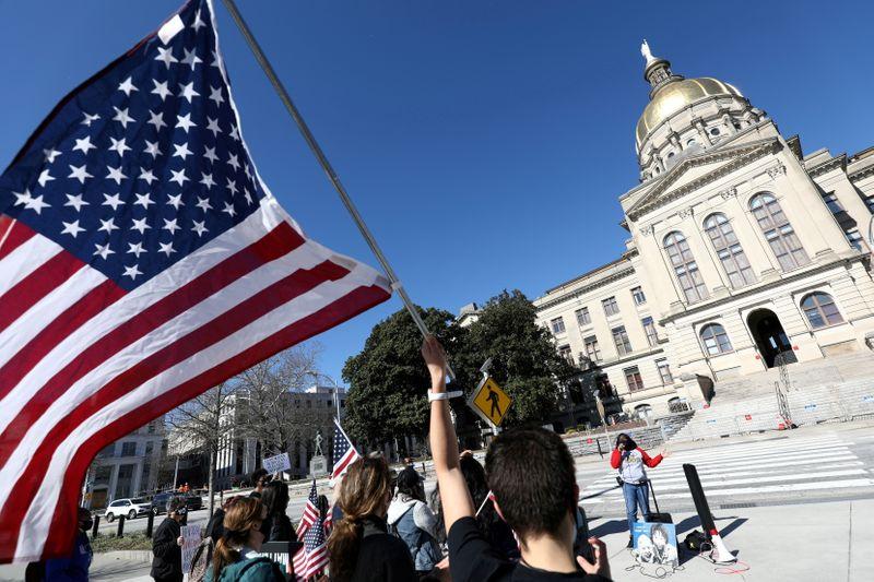 Factbox-Republicans erect voting barriers across U.S. battleground states