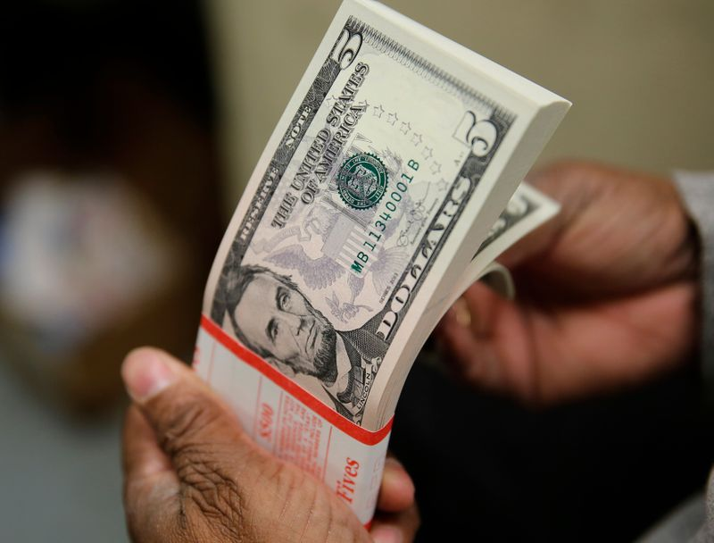 Dollar holds gains as inflation fears boost yields
