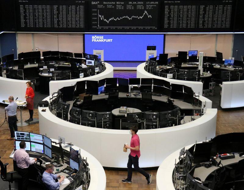 European stocks edge lower as heavyweight miners decline