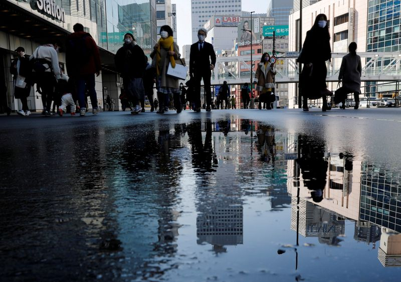 Japan PM Suga seeks minimum wage hike 'sooner', despite business resistance