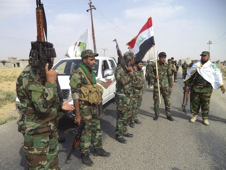 In rare alliance, Shi'ites join Sunnis to defend Iraqi towns