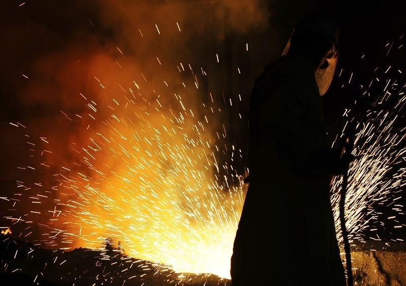 © Reuters. A labourer works at a ferronickel smelting furnace in a Fenimak factory near Kavadarci