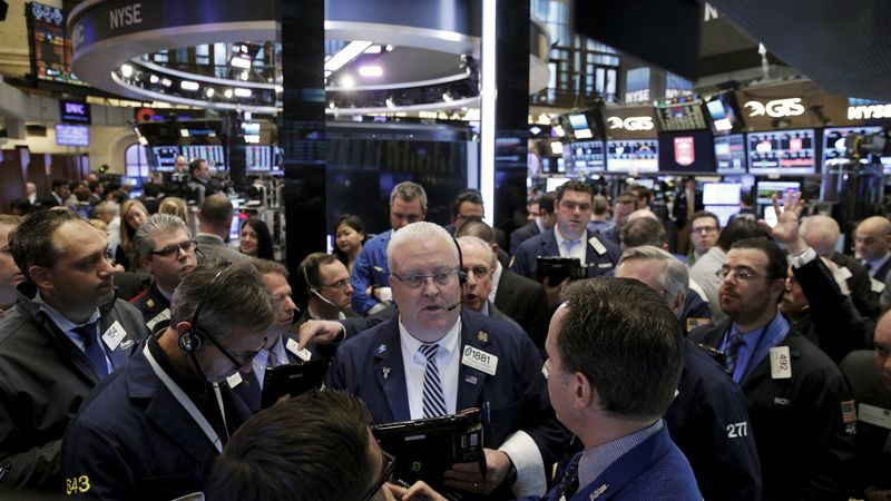 Wall Street cedes ground after mixed bag of earnings