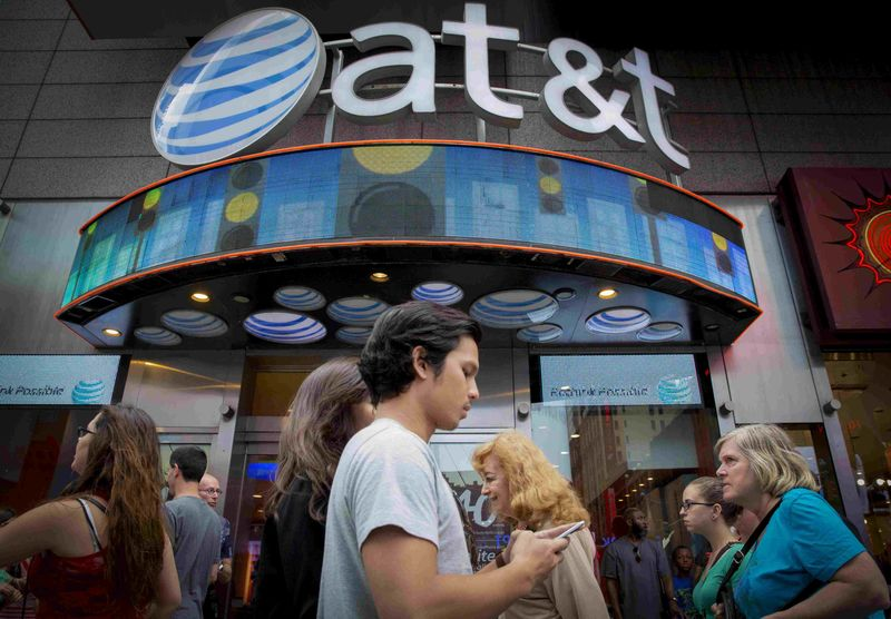 © Reuters. People walk past the AT&T store in New York's Times Square