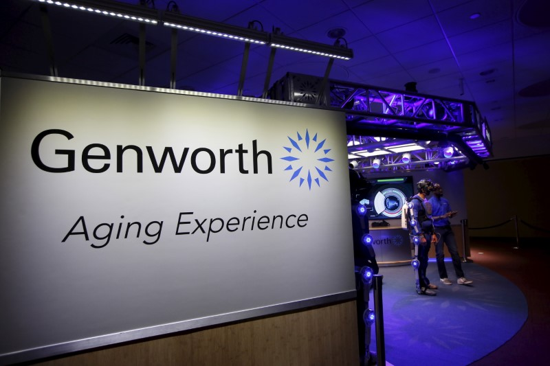 © Reuters. George Twopointoh, brand ambassador for Genworth, speaks with Ugo Dumont, a volunteer for the Genworth R70i Aging Experience, during a demonstration at the Liberty Science Center in Jersey City, New Jersey