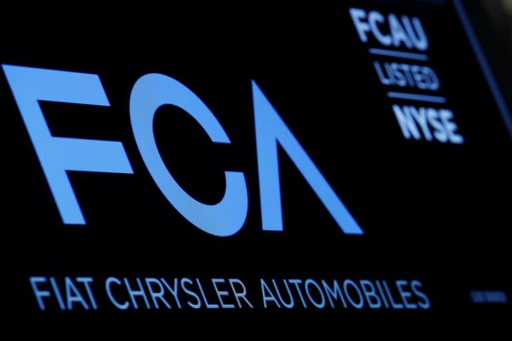 © Reuters. A screen displays the ticker information for Fiat Chrysler Automobiles NV at the post where it's traded on the floorof the NYSE