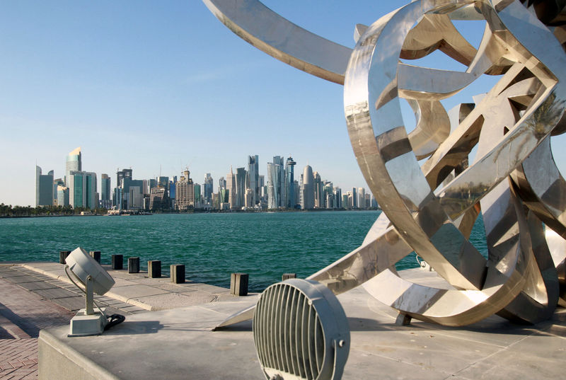 © Reuters. FILE PHOTO: Buildings are seen from across the water in Doha