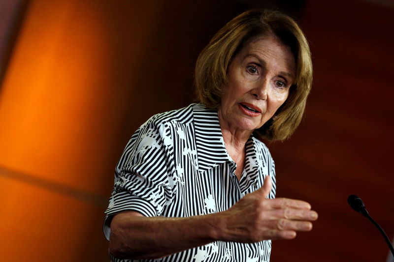 © Reuters. House Minority Leader Nancy Pelosi (D-CA) speaks at a weekly press conference