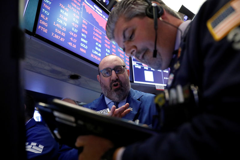 Wall Street pares losses on report of Bannon's likely exit