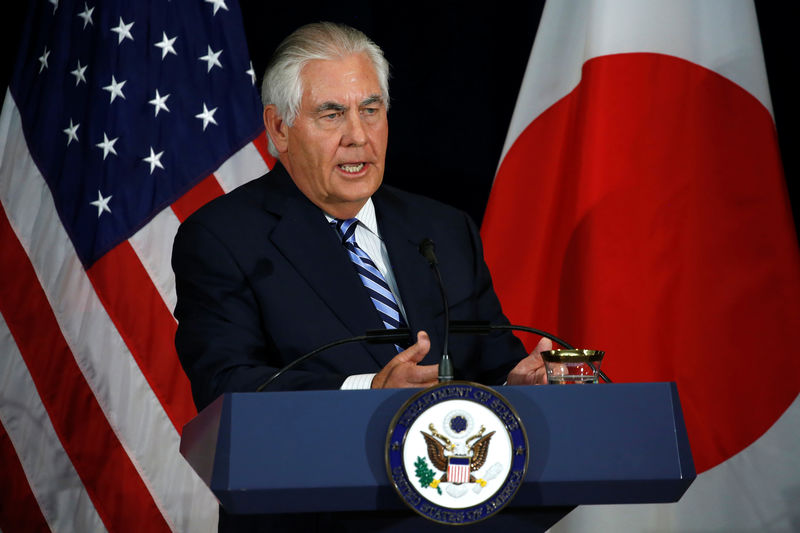 © Reuters. Tillerson, with his Japanese counterparts, addresses a news conference after their U.S.-Japan Security talks at the State Department in Washington
