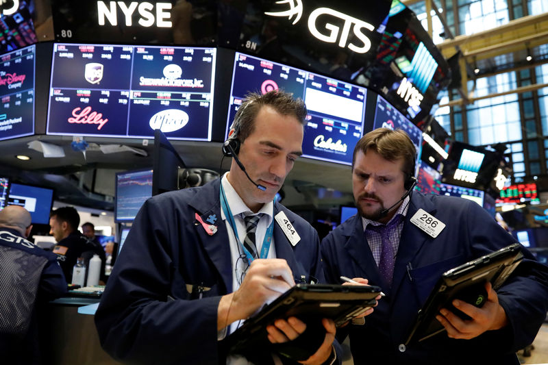 Wall Street edges lower, led by tech and financial stocks