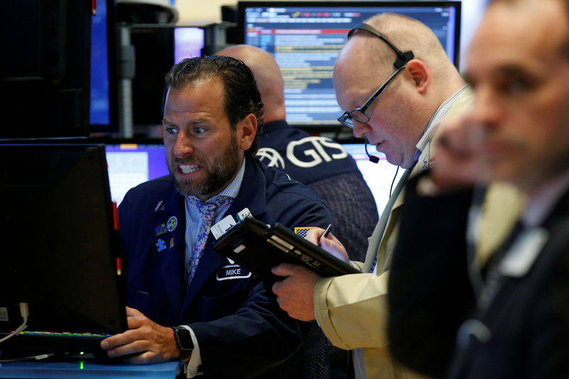 Wall Street gains as investors pick beaten-down stocks