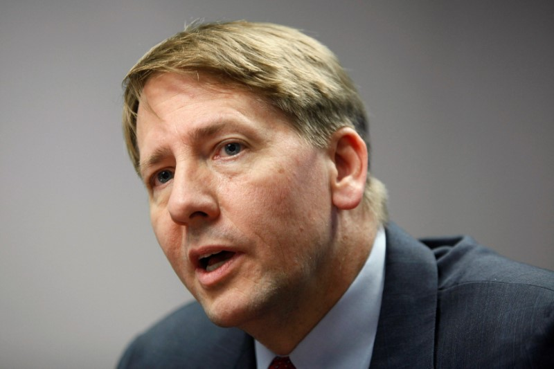 © Reuters. FILE PHOTO - Consumer Financial Protection Bureau Director Cordray answers questions at the Reuters Washington Summit in Washington