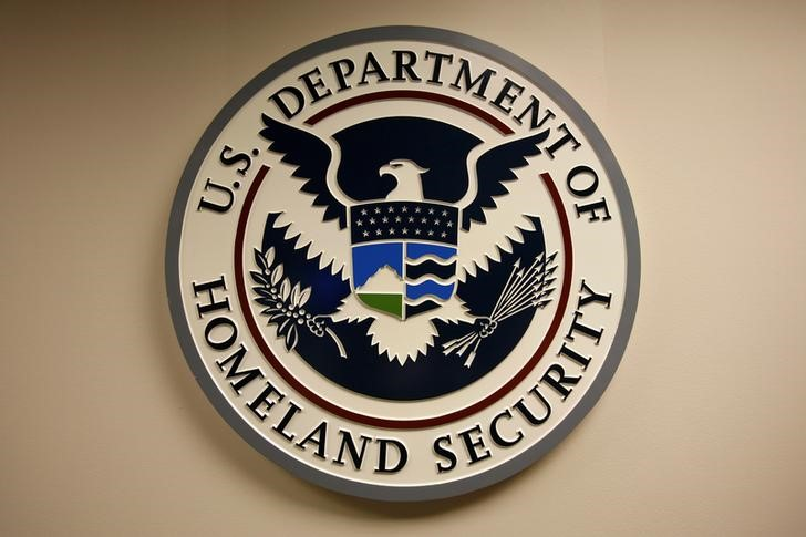 © Reuters. FILE PHOTO: U.S. Department of Homeland Security emblem is pictured at the National Cybersecurity & Communications Integration Center in Arlington