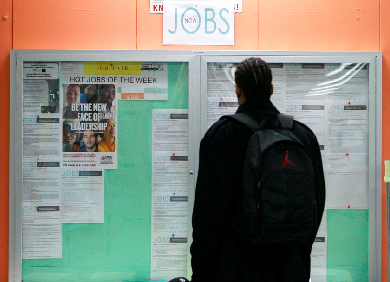 © Reuters. FILE PHOTO: A man looking at employment opportunities at a jobs center in San Francisco
