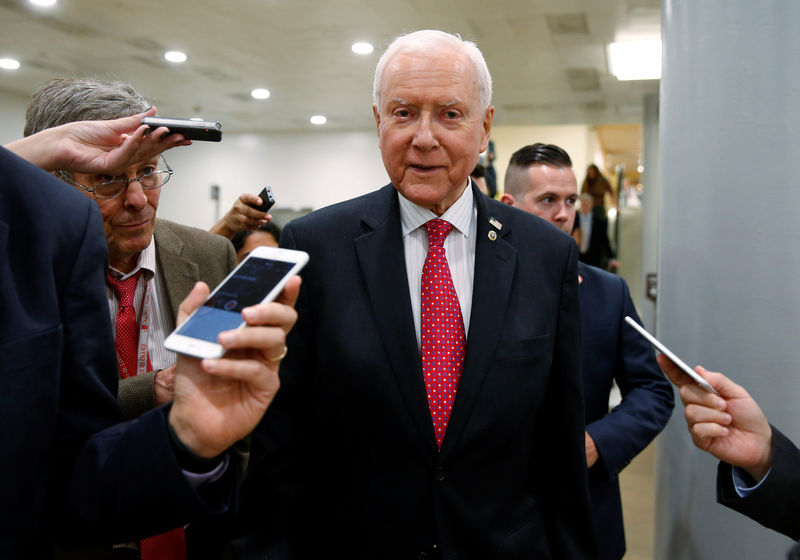 © Reuters. Senator Orrin Hatch (R-UT) speaks to reporters after the Senate approved $15.25 billion in aid for areas affected by Hurricane Harvey in Washington