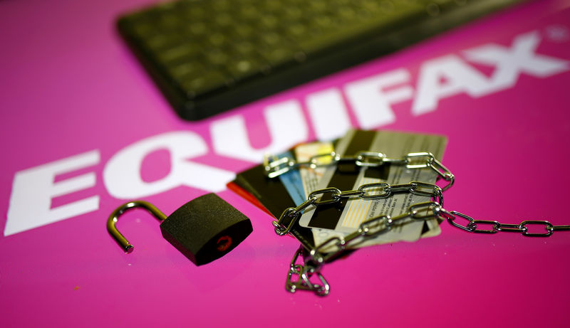 © Reuters. Credit cards, a chain and an open padlock is seen in front of displayed Equifax logo in this illustration