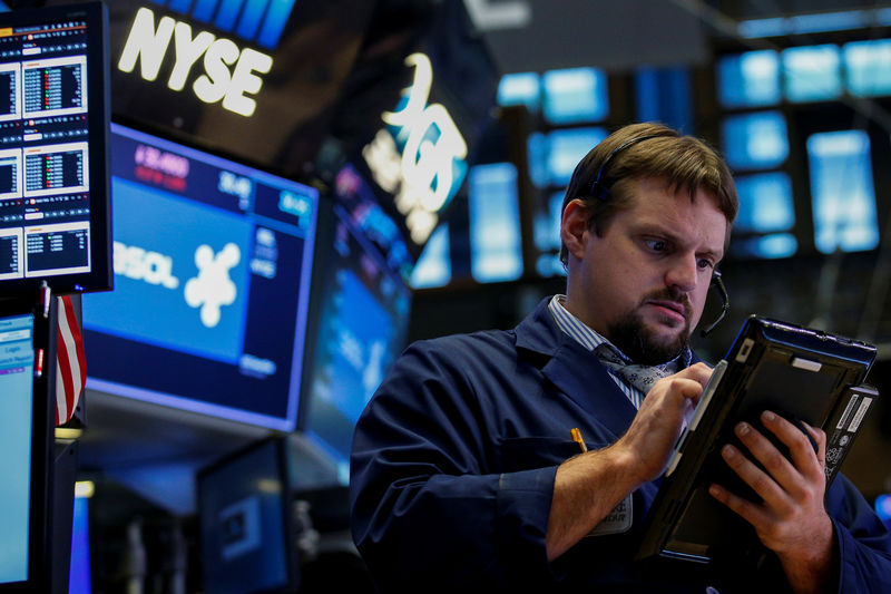 Wall St. lower as Apple, Fed view weigh