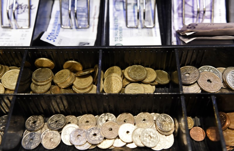 © Reuters. Coins in a cash-box of Danish crowns are pictured in a pub in Copenhagen
