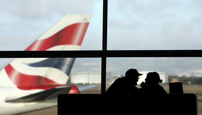 © Reuters. FILE PHOTO:A British Airways Boeing 747 passenger aircraft prepares to take off as passengers wait to board a flight in Cape Town International airport in Cape Town