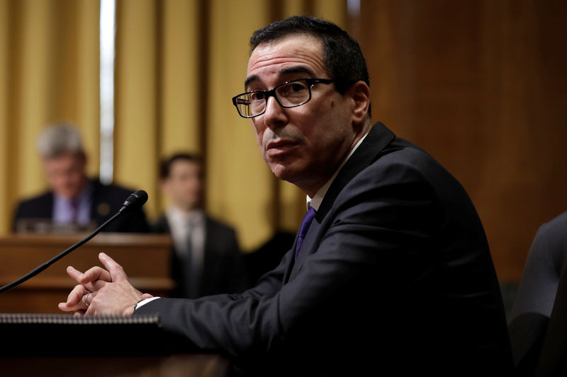 © Reuters. FILE PHOTO - U.S. Treasury Secretary Steve Mnuchin testifies before a Senate Finance Committee