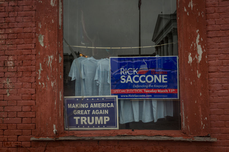 © Reuters. A window announcing support for Congressional candidate Rick Saccone is seen in Waynesburg