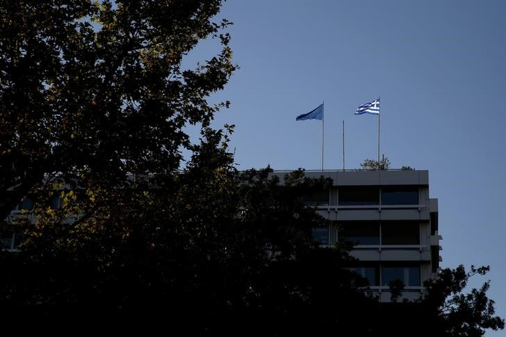 Euro zone to unlock new loans to Greece, working on debt relief By