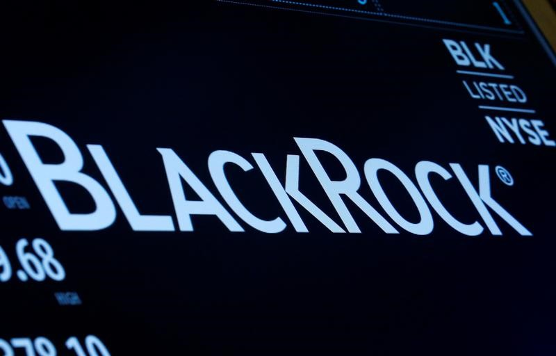 © Reuters. The company logo and trading information for BlackRock is displayed on a screen on the floor of the NYSE