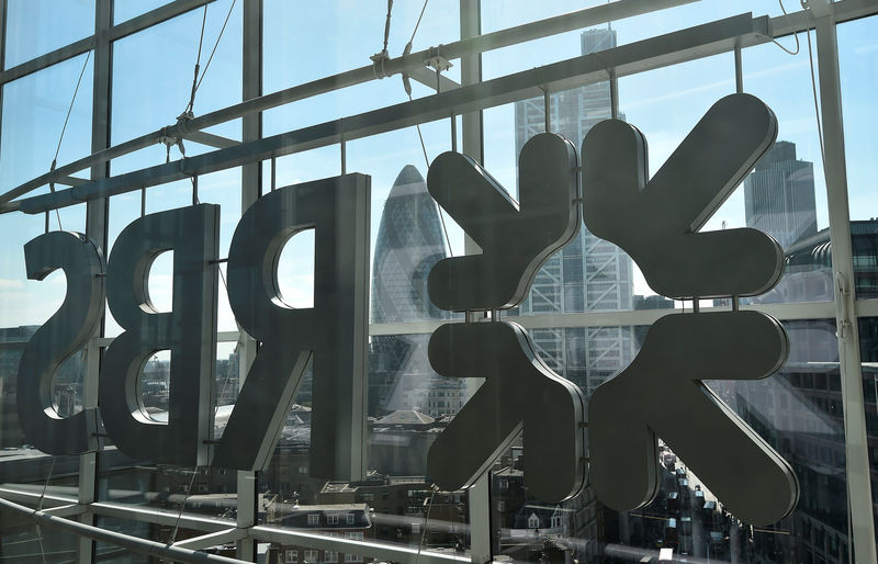© Reuters. FILE PHOTO: The City of London business district is seen through windows of the Royal Bank of Scotland headquarters in London